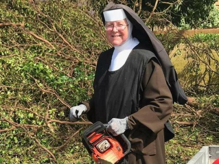 Chainsaw-wielding nun shows us how to clean up after a hurricane